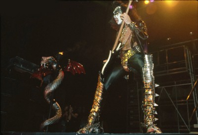 Gene Simmons Performing Near Snake Statue